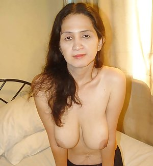 Sexy mom lying in bed