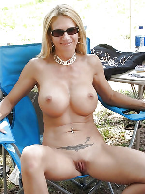 Sexy mom with big tits exposed on the chair