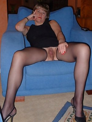 Sexy gray headed grandmother demonstrates delights and spreads legs