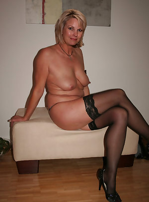 Sexy gray headed old widow demonstrates delights and spreads legs