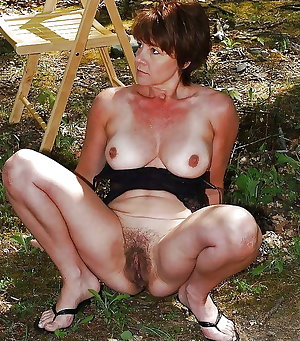 Mature on a blanket outdoors fucking