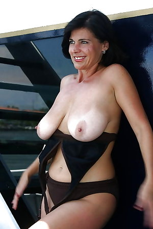 Sexy Busty Mature Milf Posing on The Deck