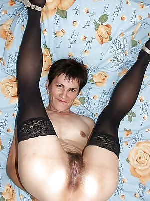 Skinny mature with small tits and nice hairy pussy